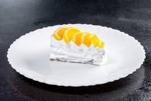 Piece of cake with white cream and citrus marmalade (Flip 2019)