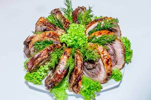 Pieces of baked meat with herbs  Flip 2019