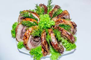 Pieces of baked meat with herbs