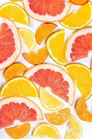 Pieces of colorful citrus fruit. Concept of healthy food, natural vitamins (Flip 2020)