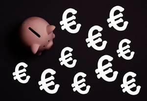 Piggy bank with Euro symbols