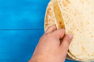 Pile of Tortillas in the hand