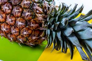 Pineapple on yellow green background