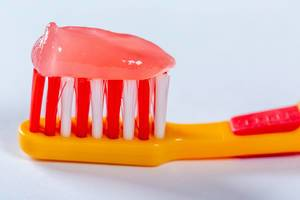 Pink Toothpaste on a Baby Toothbrush