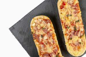 Pizza Baguette on the black stone tray