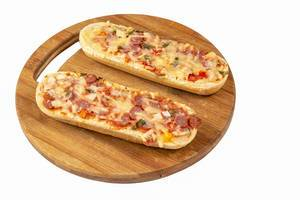 Pizza Baguette on the round wooden board (Flip 2019)