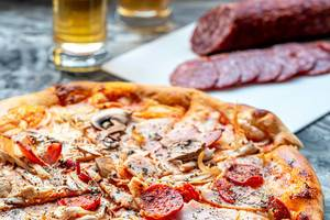 Pizza-cold-cuts-with-ham-chicken-and-smoked-sausage-on-the-grey-table.jpg