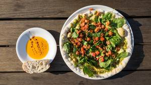 Pizza Vegitalia: vegan pesto, baby spinach, bruschetta tomatoes