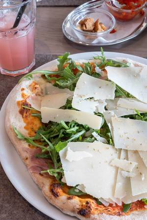 Pizza with Parmesan, Rucola and Parma ham