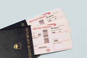 Plane tickets lying in passport