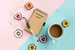 planner for 2018 year, coffee and marzipan cookies. top view