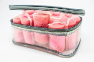 Plastic case with many pink sponge hair curlers (Flip 2019)