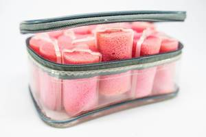 Plastic case with many pink sponge hair curlers