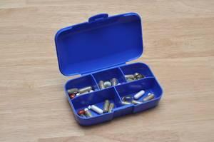 Plastic manual pillbox to sort medication and drugs