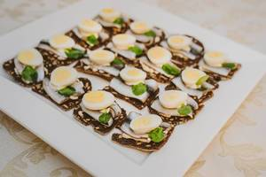 Plate Of Anchovies And Egg Canape Snacks