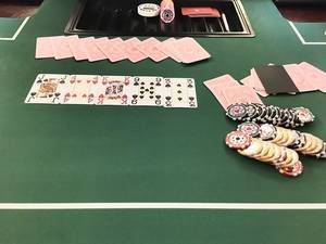 Playing poker: cards and chips on a green table