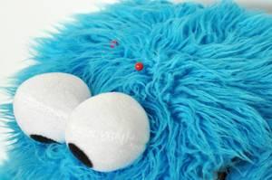Plüschtier blaues, haariges Monster