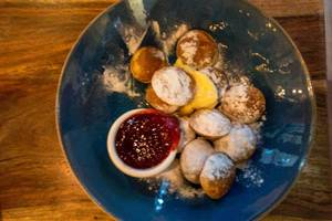 Poffertjes with powdered sugar and marmalade
