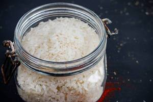Polished white rice in glass jar