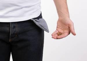 Poor man showing empty pocket