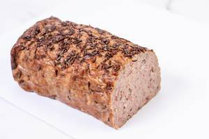 Pork and Chicken Meat Loaf with Cumin above white background (Flip 2019)