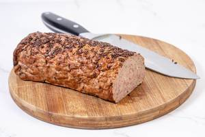 Pork and Chicken Meat Loaf with Cumin on the wooden board (Flip 2019)