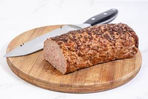 Pork and Chicken Meat Loaf with Cumin on the wooden board