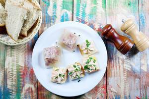Pork jelly served with homemade bread, salt and pepper. Wooden vintage background (Flip 2019)