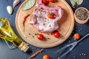 Pork meat with olive oil, cherry tomatoes and spices