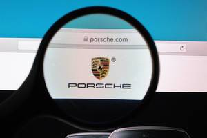 Porsche logo under magnifying glass