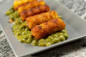Potato Croquettes with Cooked Green Peas served on the plate (Flip 2019)