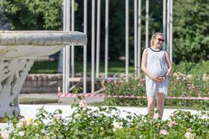 Pregnant woman posing for photo in Gorky Park