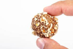 Preparing heatly Oatmeal cookie balls with Almonds in the hand (Flip 2019)