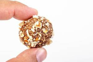 Preparing heatly Oatmeal cookie balls with Almonds in the hand