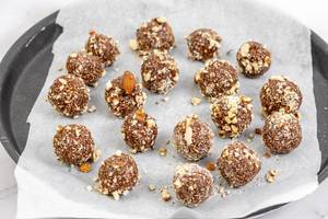 Preparing heatly Oatmeal energetic cookie balls with grated Almonds