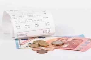 Printed receipt and Euro money on white background