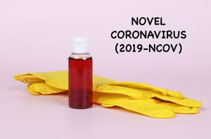 Protective gloves with blood sample and Novel Coronavirus text