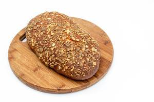 Protein Bread with Pumpkin seed on the wooden board (Flip 2019)