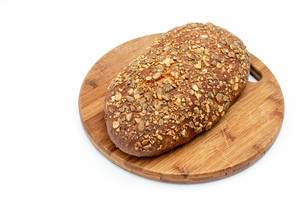 Protein Bread with Pumpkin seed on the wooden board