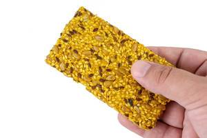 Protein Curcuma Cereals Crackers in the hand (Flip 2019)