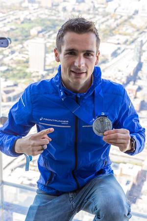 Proud ASICS Frontrunner shows the medal received after the Chicago Marathon 2019