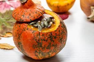 Pumpkin puree with pumpkin seeds. Halloween food concept (Flip 2019)