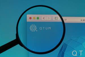 QTUM logo under magnifying glass