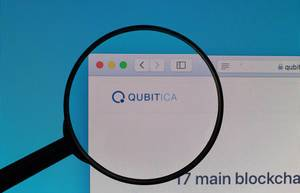 QUBITICA logo under magnifying glass