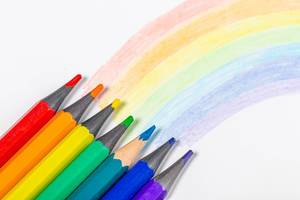 Rainbow and pencils of rainbow colors on white background (Flip 2019)
