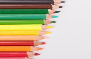 Rainbow color pencils aligned in a row