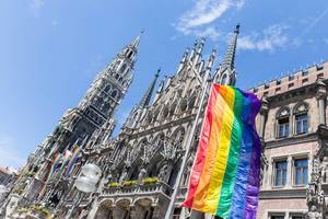 Rainbow flag as international symbol of the gay-lesbian community at Marienplatz, during the CSD-Technoparade for Munich Pride
