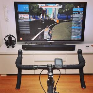 Raining outside, training inside. @gozwift is the World of Warcraft for cyclists. #zwift #gozwift #strava #cycling #training #triathlontraining #ironmantraining #happy