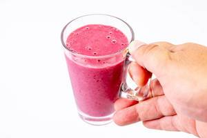 Raspberry Banana and Blackberry Smoothie in the hand (Flip 2019)