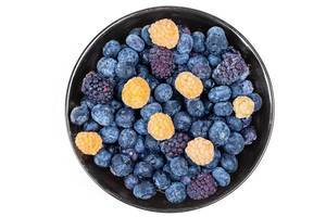 Raspberry, blueberry and mulberry berries in a bowl on a white background, top view (Flip 2020)